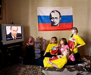 <strong>Young Putin fanclub members watching Putin at home on television</strong>