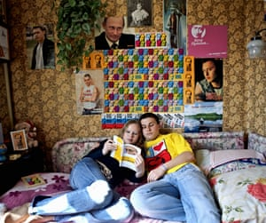 <strong>A couple who both belong to the fanclub read Putin's book My Ideology at their home in Moscow</strong>