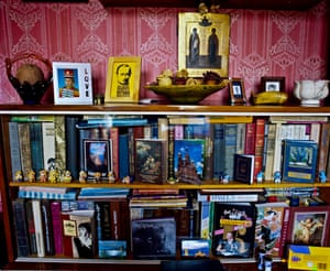 <strong>Bookshelves packed with Putin merchandise and memorabilia at fanclub member Tanya Arkhipova's Moscow home</strong>