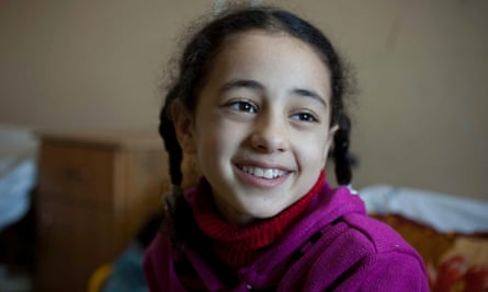 Weam Al Astal, pictured two days after she had an operation on her leg in al-Shifa Hospital.