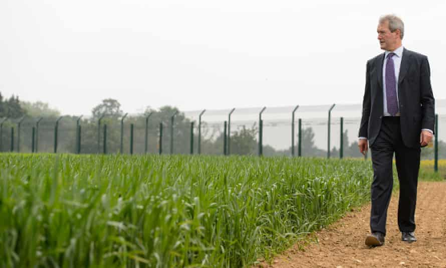 Former UK environment secretary Owen Paterson views a genetically modified crop trial during a visit to Rothamsted Research, Hertfordshire.