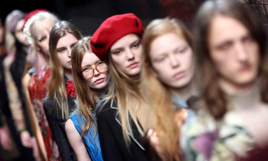 Models parade at the end of the Gucci's first womenswear show under Alessandro Michele at Milan fashion week.