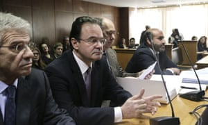Former Greek finance minister George Papaconstantinou, second left, in court on Wednesday.