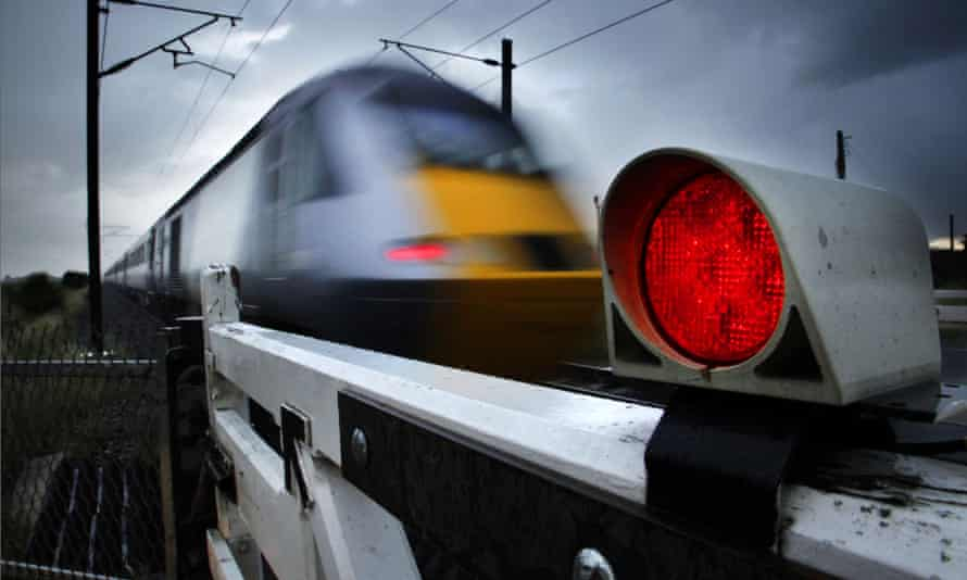 National Express train on a level crossing on the East Coast main line at Fenwick north of Doncaster.