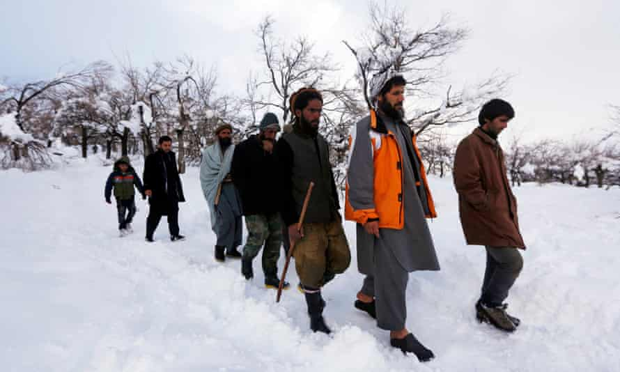 Relatives of avalanche victims return after conducting a search for the victims in Panjshir.
