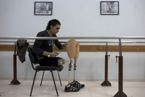 Palestinian Mustafa Majedah,19, during a rehabilitation session at the Artificial Limbs and Polio Centre in Gaza City. Mustafa lost his legs when a bomb hit outside his home in Khan Younis