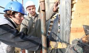 An apprentice on a building site