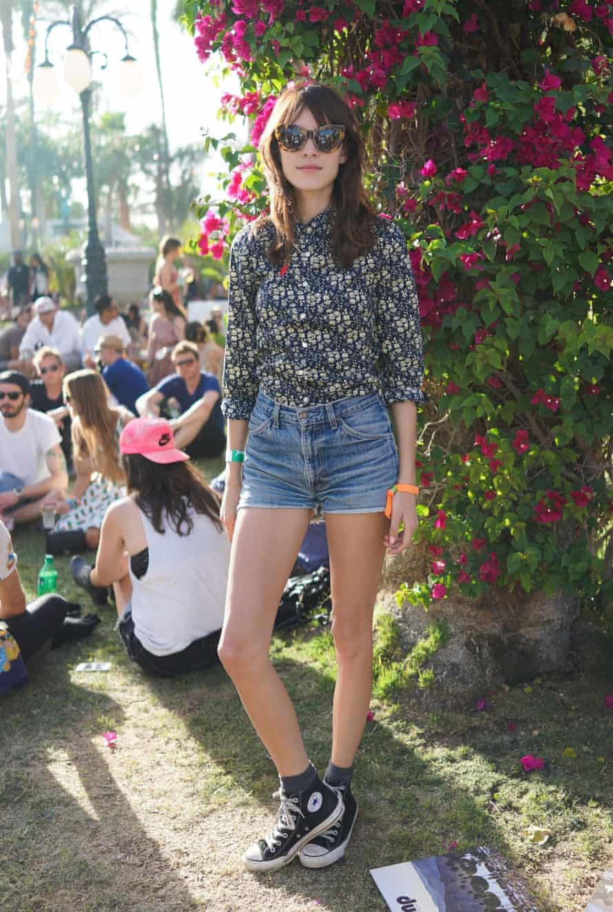 Alexa Chung wearing Converse trainers at the Coachella Music Festival in 2013.