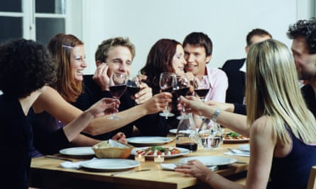 Group talking at dinner party