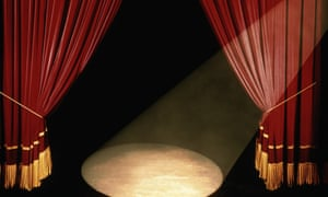 Theatre curtains and spotlight on an empty stage