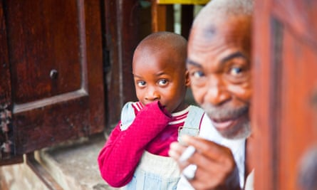 A young boy and his grandfather in Mombasa, Kenya. British American Tobacco controls 70% of the tobacco market in this east African country.