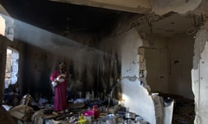 Ramba Kafanah breastfeeds her new born baby in the kitchen of her damaged home Human cost of the Israel Gaza conflict, Gaza, Palestinian Territories - Feb 2015