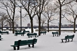 Empty Park in Winter The Esplanade along the Charles River in Boston. Snow on the benches keeps people away (so do the temperatures).