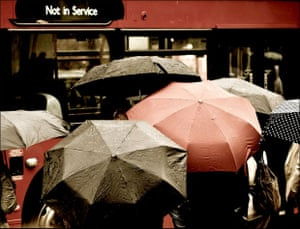 """Not in Service Rainy day in London. People waiting for bus.. and the only one that shows up is """"Not in Service"""""""