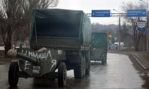 Ukrainian military trucks move cannons from their position in the eastern Ukrainian city of Mariupol.