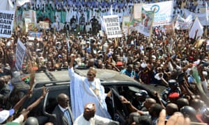 All Progressives Congress presidential candidate Muhammadu Buhari, centre, raises his hand during a campaign rally in the north-east city of Maiduguri earlier in February.