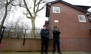 Police at homes in west London where Mohammed Emwazi is believed to have lived.