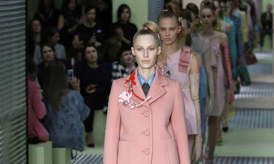 Models wear creations for Prada women's autumnl-winter 2015 collection at Milan fashion week.