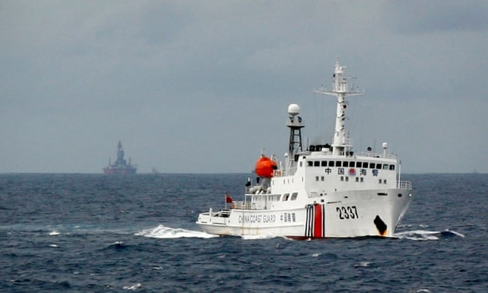 A Chinese Coast Guard vessel passes near the Chinese oil rig, Haiyang Shi You 981 in the South China Sea, about 210 km (130 miles) from the coast of Vietnam. The US says it is concerned at China's aggressive exertion of sovereignty in the sea.