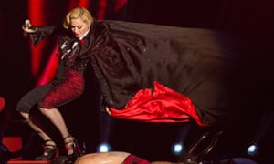 Madonna falls as she performs on stage for the Brit Awards 2015 at London's O2 Arena.