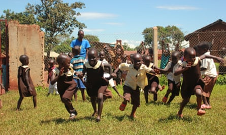 Children running a race Uganda