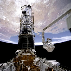 Hubble being fixed serviced astronauts