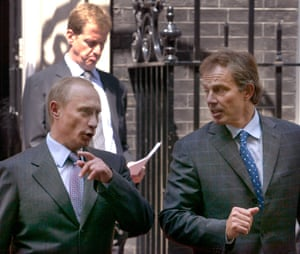 Vladimir Putin, Alastair Campbell and Tony Blair in Downing Street in 2003.