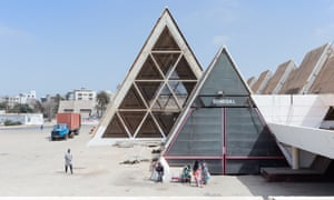 Some of the many triangular prisms that form the FIDAK exhibition centre, which was built in 1975 in the Senegalese capital Dakar to host the country's biennial international trade fair. Designed by French architects Jean Francois Lamoureux and Jean-Louis Marin
