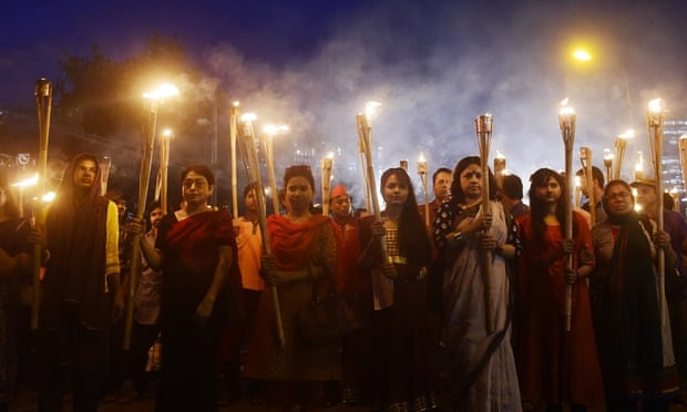Bangladeshi secular activists take part in a torch-lit protest against the killing of Avijit Roy