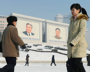 Portraits of North Korea's national founder Kim Il Sung (left) and late leader Kim Jong Il in Pyongyang, North Korea.