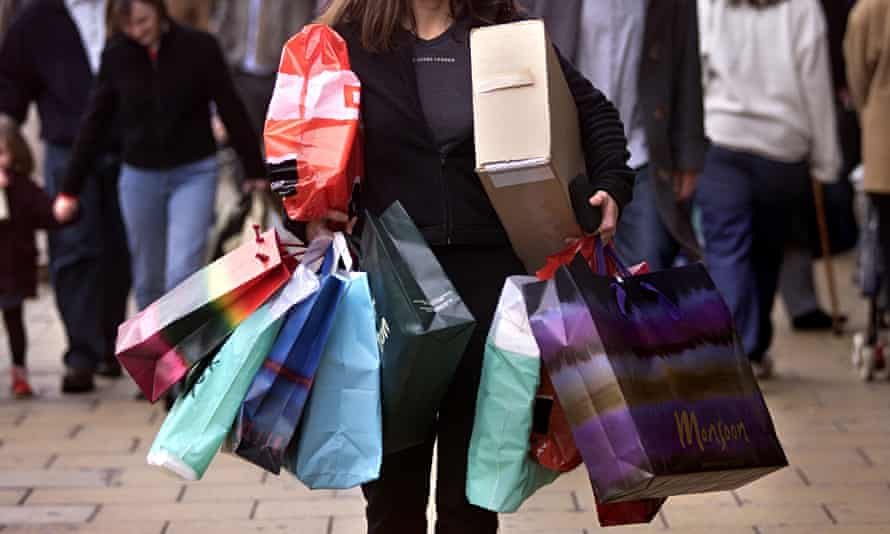 A woman carrying several shopping bags