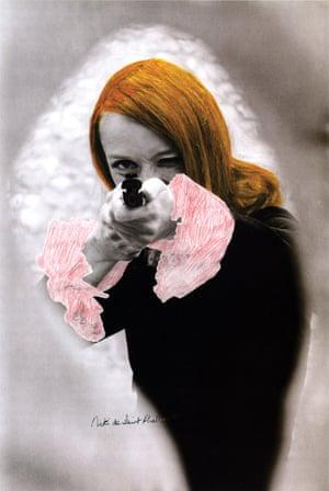 Niki de Saint Phalle pointing her gun, 1972.