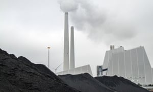 A mound of coal used to fuel Dong Energy's Avedore 1, a coal-fired CHP power plant is seen stored at the company's Avedoerevaerket site in Hvidore, Denmark, on October 15, 2013. Dong Energy A/S, Denmark's largest utility is selling shares as part of a financial restructuring announced in February to cut costs, reduce debt and bolster investments in oil and gas exploration as well as wind farms.