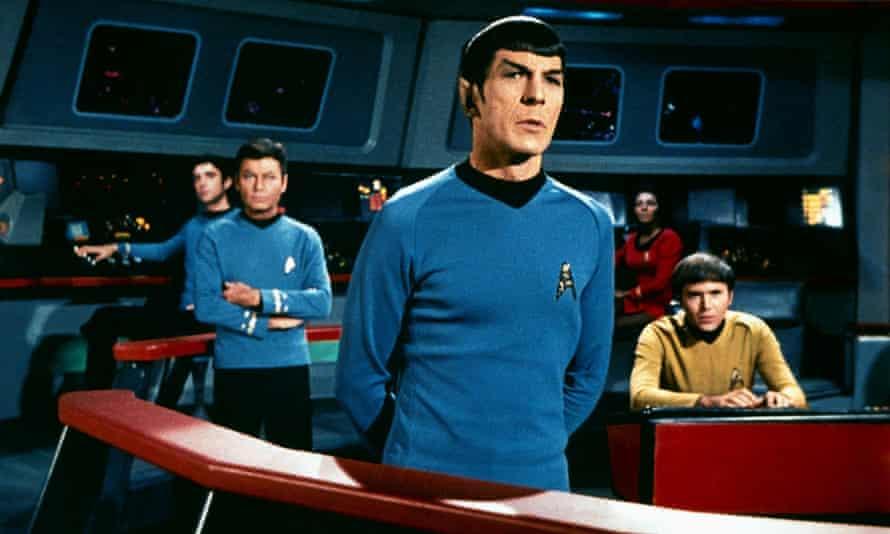 Deforest Kelley, Leonard Nimoy, Nichelle Nichols and Walter Koenig in Star Trek.