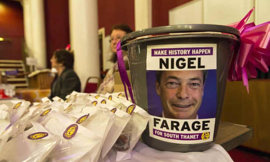 A donation bucket featuring a photos of Nigel Farage at Ukip's spring conference in Margate.
