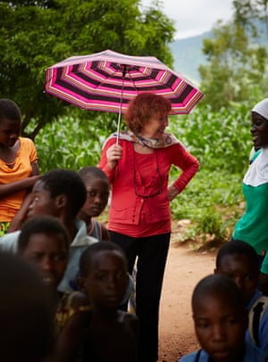 'We don't send in outsiders to tell them what to do.' Ann Cotton with Camfed pupils in Malawi – she says staff are recruited only from within Africa.