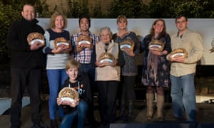 Jorge Pereira and Betty Lethbridge, fourth and fifth from left, with the other winners.