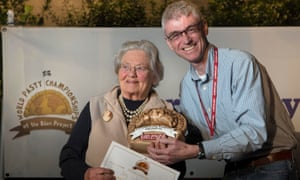 Betty Lethbridge receives her prize on Saturday.