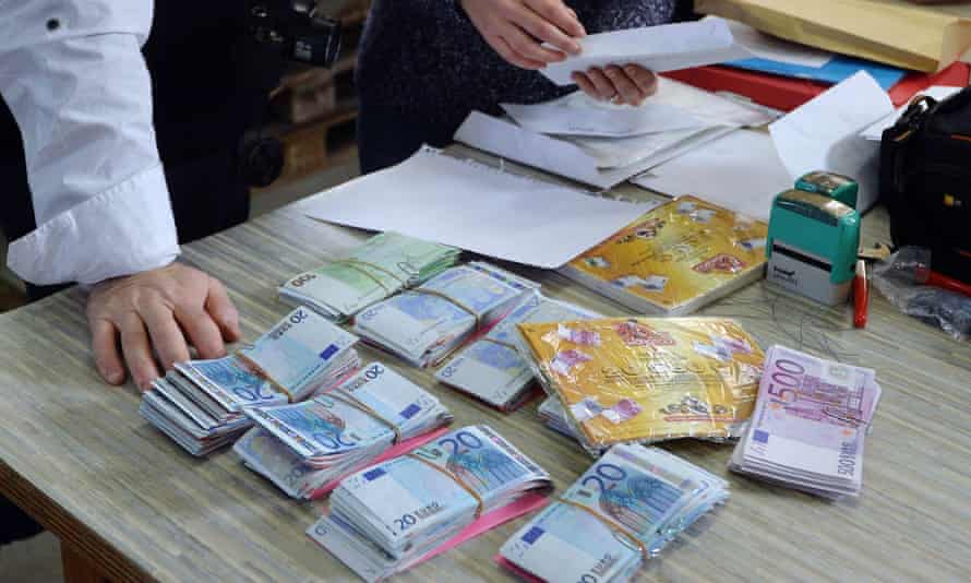 Employees prepare envelopes with banknotes during a secret operation in Saint-Avold, eastern France.