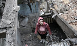 A woman stands in what remains of her house in central Donetsk, eastern Ukraine, on 2 February, 2015. Artillery attacks on the Ukrainian city of Donetsk killed at least one civilian on Monday.