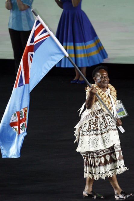 Flag bearer Cacau Turagabeci carries the Fiji flag at the opening ceremony for the 2006 Commonwealth Games in Melbourne.