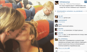 Instagram user infinitykseniya posts her Lesbian kiss in front of an 'anti-LGBT' politician on a plane