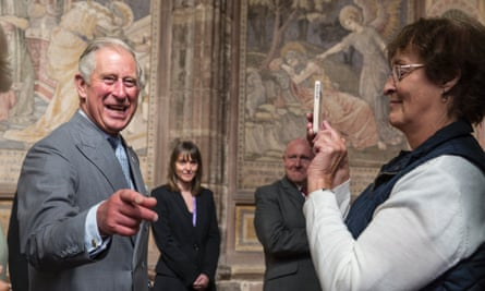 prince charles laughing while photographed