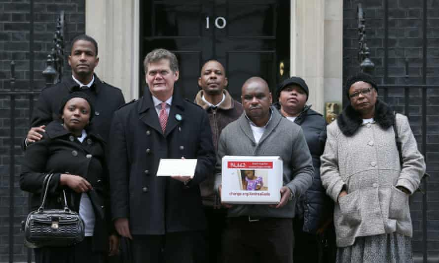 Supporters of the Gada family, including local MP Stephen Lloyd (third from left), hand in a petition at 10 Downing Street on 27 January.