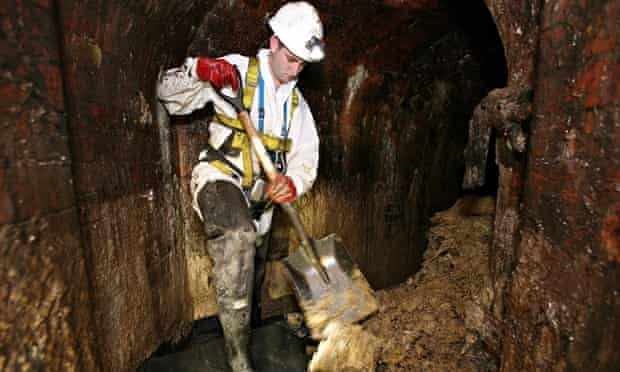 Thames Water worker removes fat from a sewer
