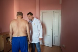 Andrei Semivolos with a patient at the National Cancer Institute in Kiev, Ukraine.