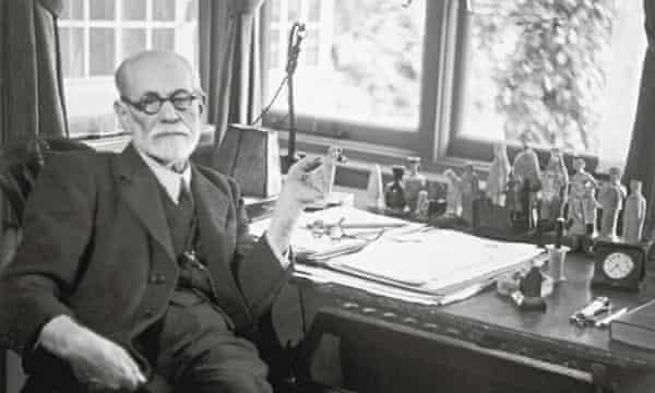 Sigmund Freud at his desk.