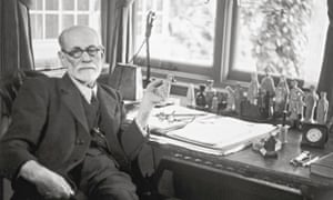 Sigmund Freud at his desk.