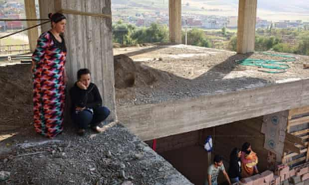 Great expectations: residents of unfinished buildings near the city of Zakho wait for the arrival of Vian Dakhil.