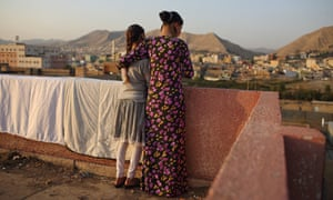 On the run: two Yazidi girls who escaped captivity from Isis militants on the roof of a school in Duhok.